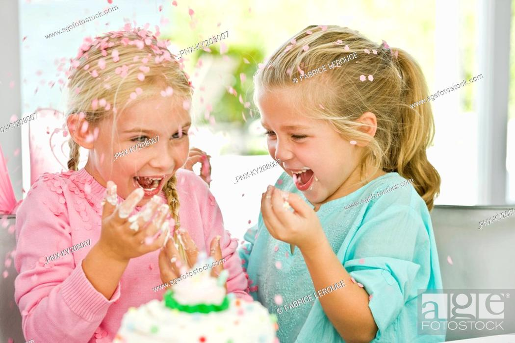Stock Photo: Two girls enjoying a birthday party.