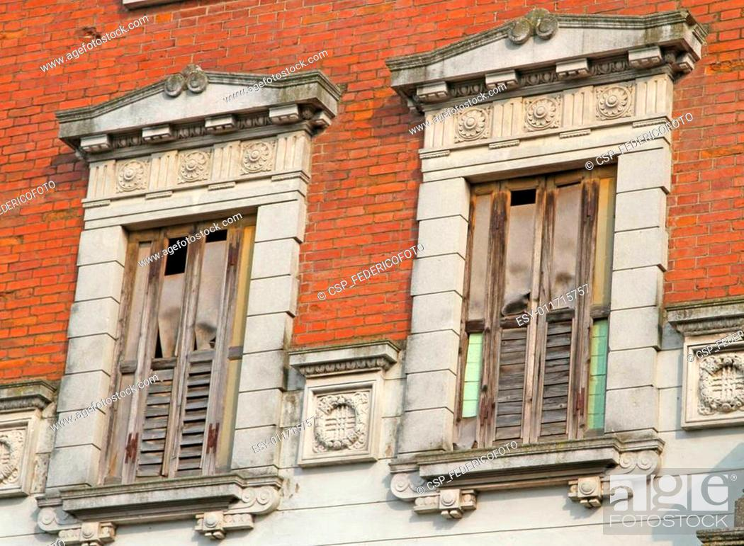 Stock Photo: balconies and wooden fixtures ruined and destroyed of an ancient.