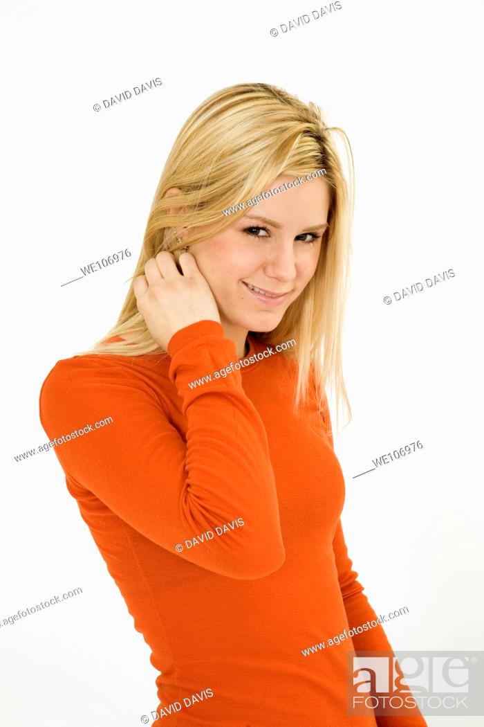 Stock Photo: Young woman posing on white background with some attitude.