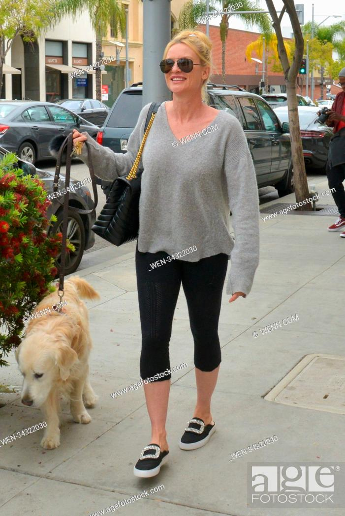 """Stock Photo: Nicollette Sheridan Walking Her Dog In Beverly Hills after enjoying lunch at """"""""E. Baldi"""""""" restaurant. Featuring: Nicollette Sheridan Where: Beverly Hills."""