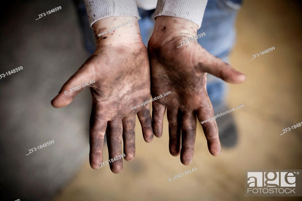 Stock Photo: Hand of a ten years old boy dirty with black paint.