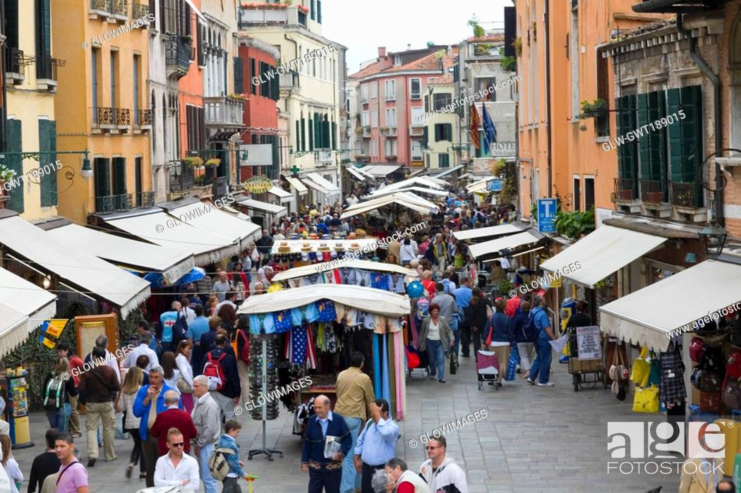 Stock Photo: Tourists in a street market, Venice, Italy.