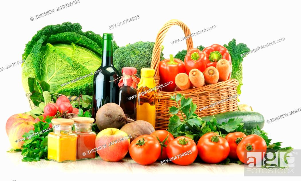 Stock Photo: Raw vegetables and wicker basket isolated on white.