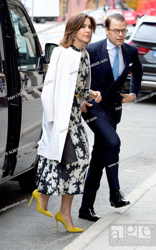 """Stock Photo: Prince Daniel of Sweden and Crown Princess Mary of Denmark arrive at the Danish Embassy in Stockholm, on May 30, 2017, on occasion of the event """"""""Liveable."""