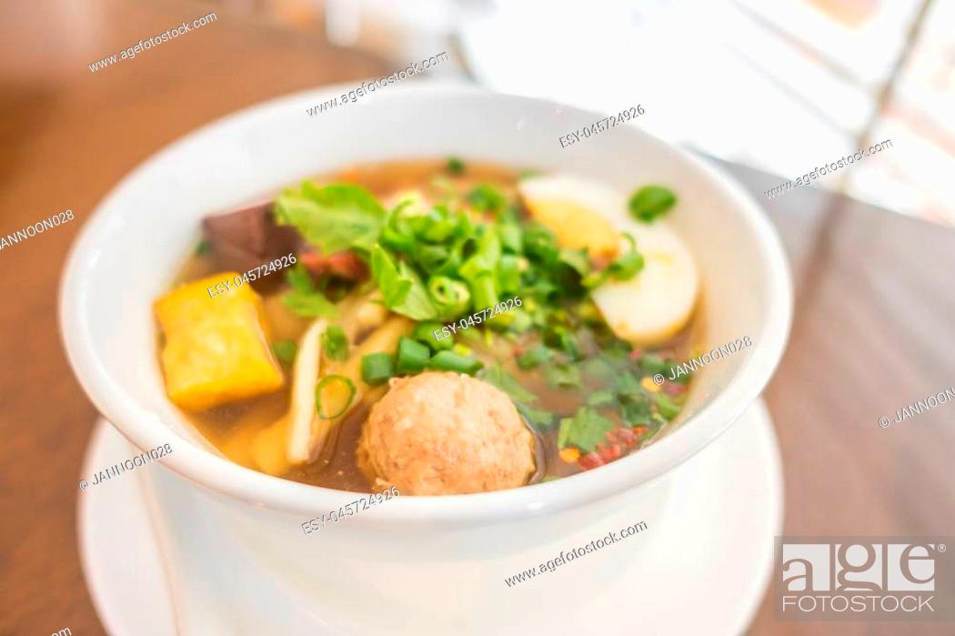 Stock Photo: Bowl of noodles with vegetables.