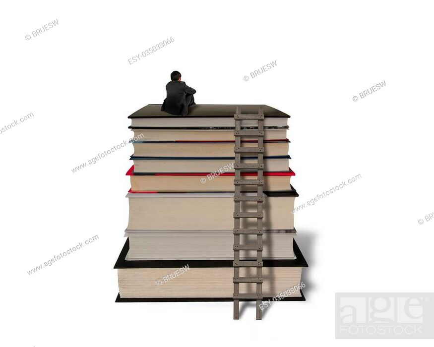 Stock Photo: Businessman sitting on top of stack books with wooden ladder in white background.