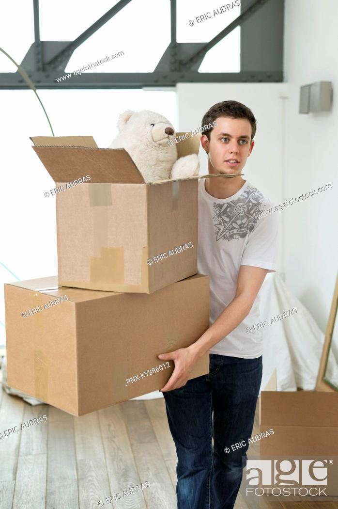 Stock Photo: Man carrying cardboard boxes.