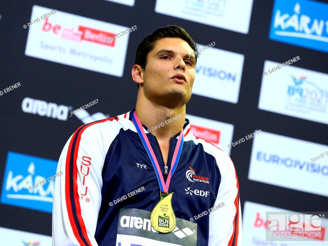 Stock Photo: First placed Florent Manaudou of France poses with his medal after the Men's 50m Butterfly Final at the 32nd LEN European Swimming Championships 2014 at the.