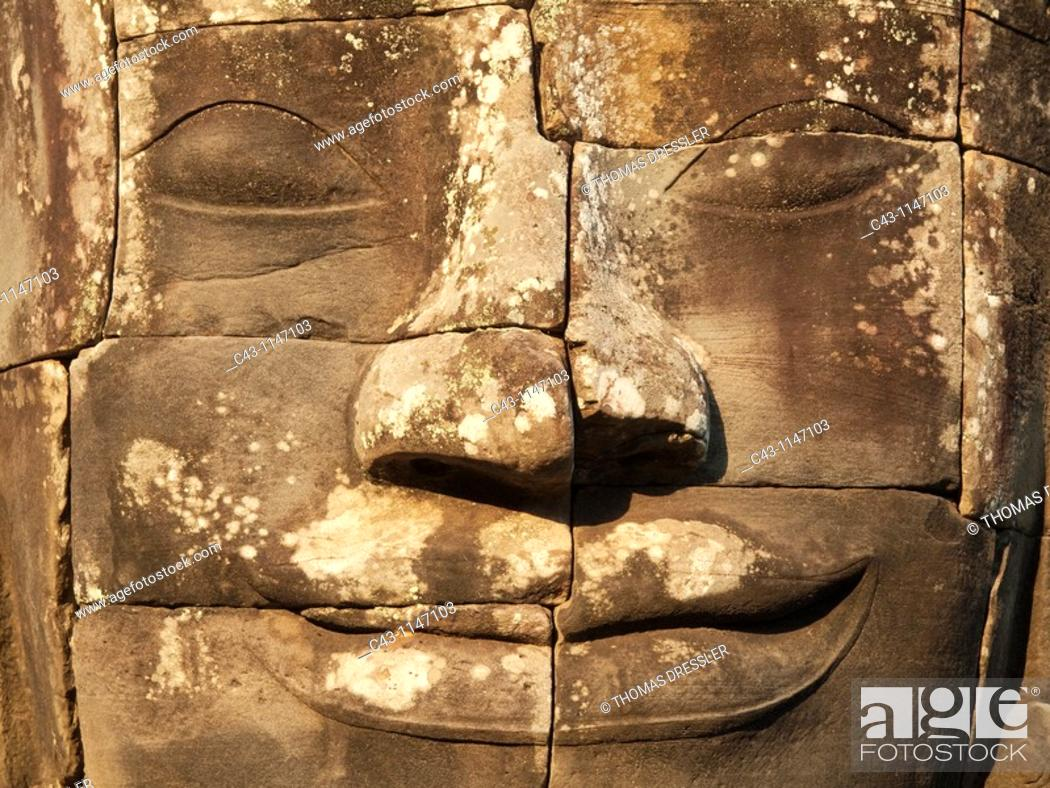 Stock Photo: Cambodia - The face of Lokeshvara 'Lord of the World' in the Bayon, a temple in the centre of Angkor Thom, the 'Great Capital' of the Khmer empire in Angkor.