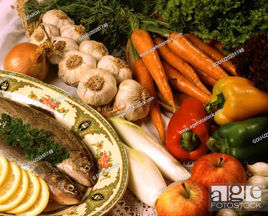 Stock Photo: A variety of vegetables and fish.