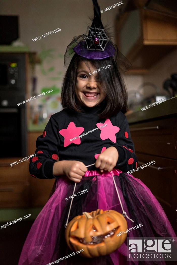 Stock Photo: Portrait of little girl dressed up as a witch at Halloween.