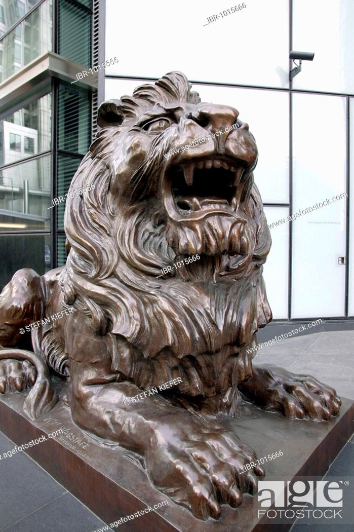 Lion sculpture in front of the entrance of the HSBC bank in Canary