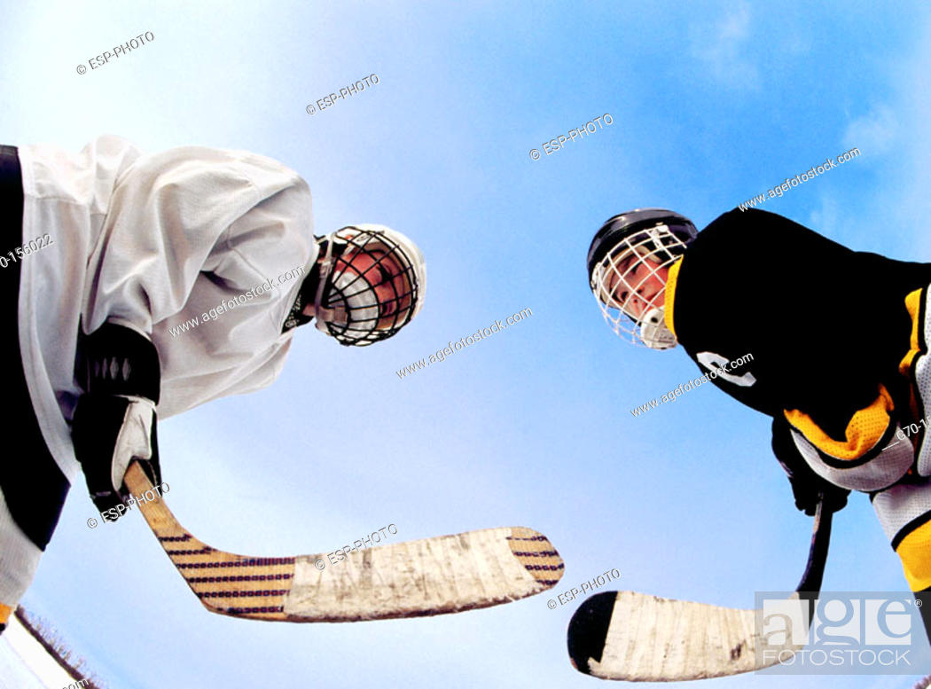 Stock Photo: Hockey players in face off.