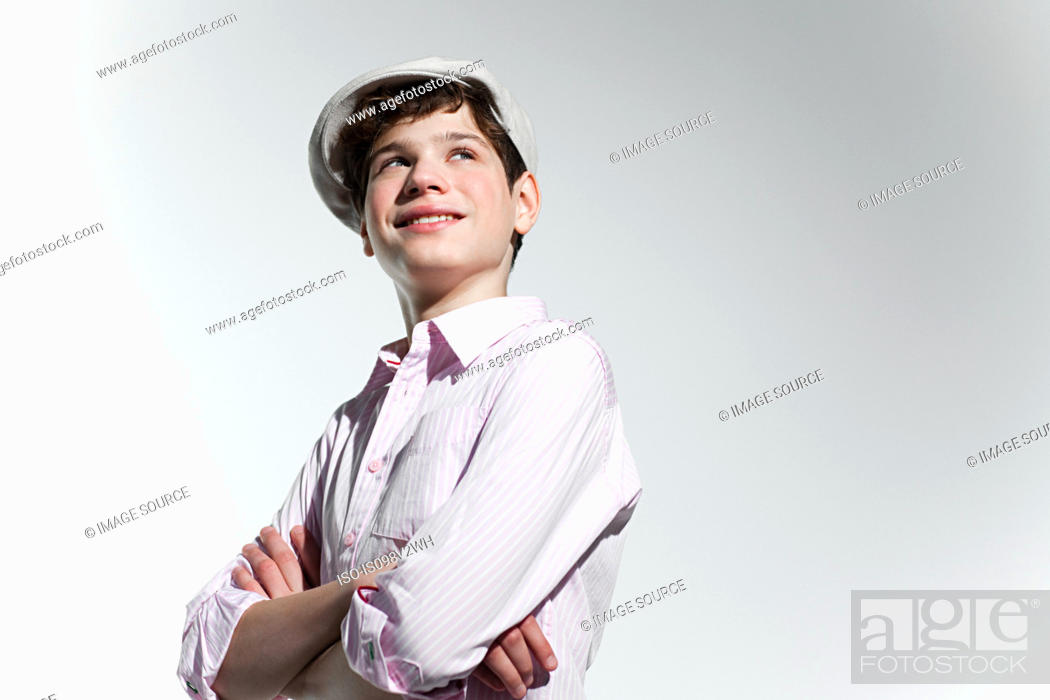 Stock Photo: Boy looking up and smiling.