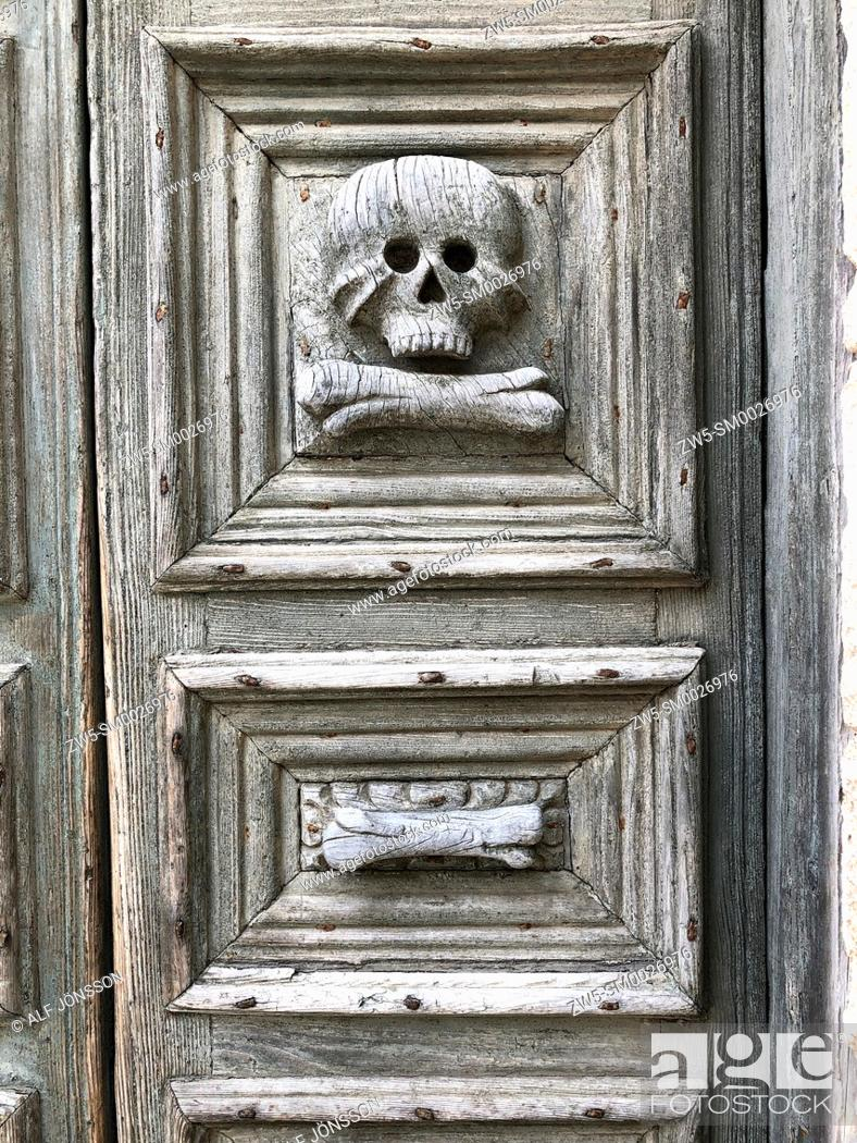 Stock Photo: Skull and bone carved on the door of the Church of Purgatory, Matera, Basilicata. Italy.