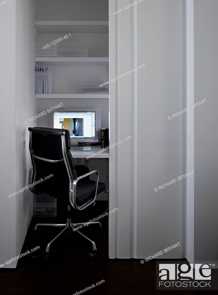 Stock Photo: Workspace with Eames aluminium chair in Bayswater apartment, London, UK.