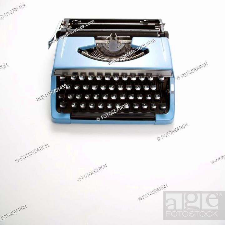 Stock Photo: Blue vintage typewriter on white background.