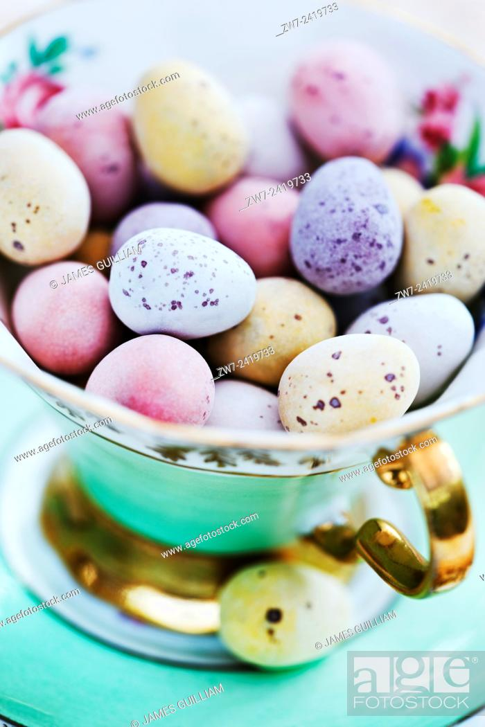 Stock Photo: Candy coated chocolate easter eggs in antique china tea cup.