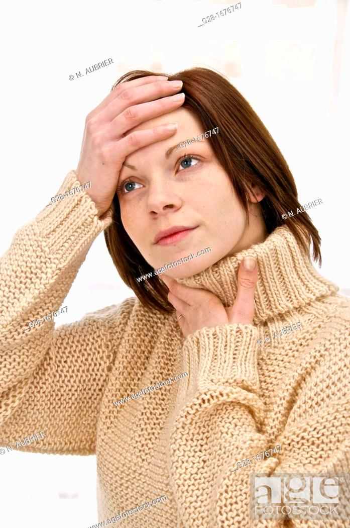 Stock Photo: Young woman in a beige turtleneck pullover, feeling sick, holding her sore throat and headache.