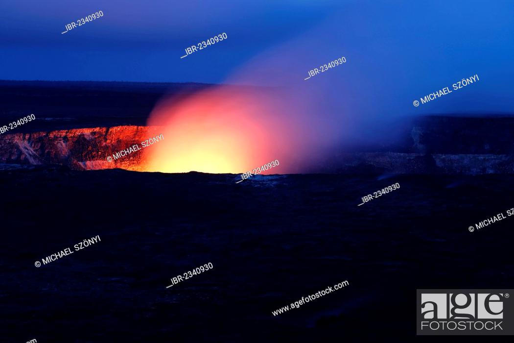 Stock Photo: Halema'uma'u crater at night from the Kilauea Overlook, Hawaii Volcanoes National Park, Big Island, Hawaii, USA.