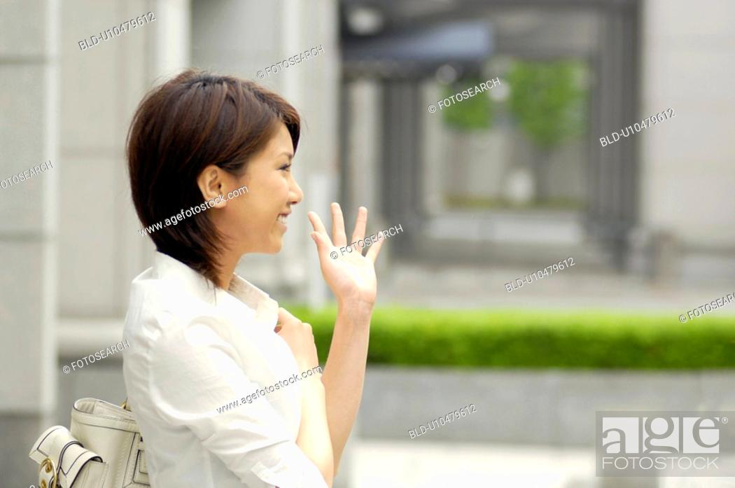 Stock Photo: Woman who waves a hand.