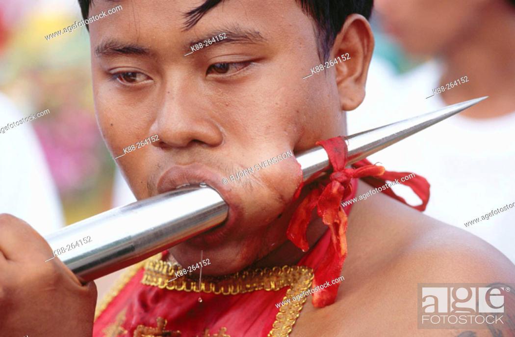 Stock Photo: Self torturing spirit medium at the Vegetarian Festival. Phuket. South Tahiland.