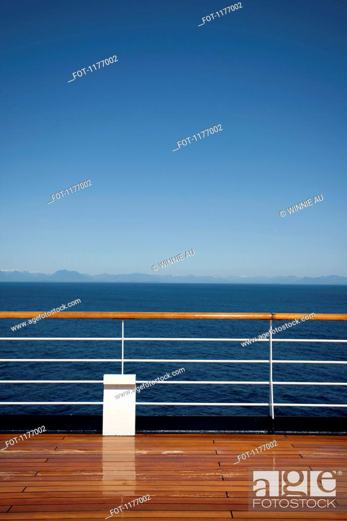 Stock Photo: Sun shining on the boat deck of a passenger ship, Canadian coastline in background.
