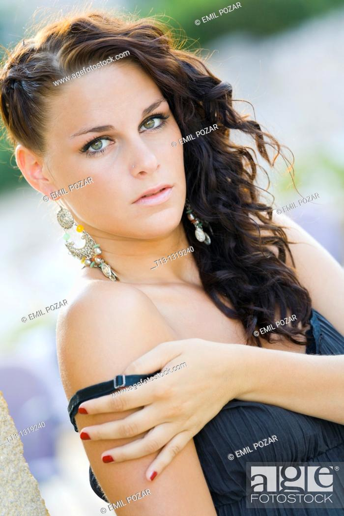Stock Photo: Pretty young woman is exposing shoulder.