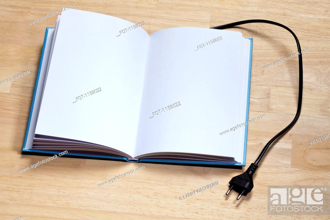 Stock Photo: A hardcover book with an electric plug attached to it.