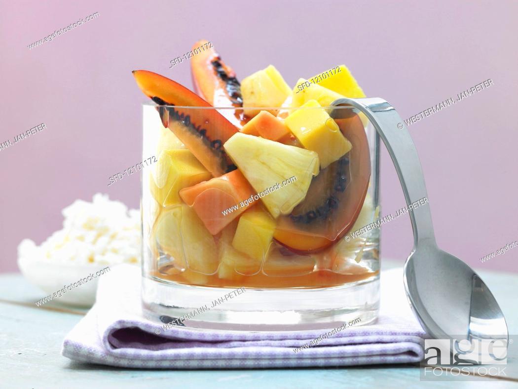 Stock Photo: Exotic fruit salad with piña colada granita.