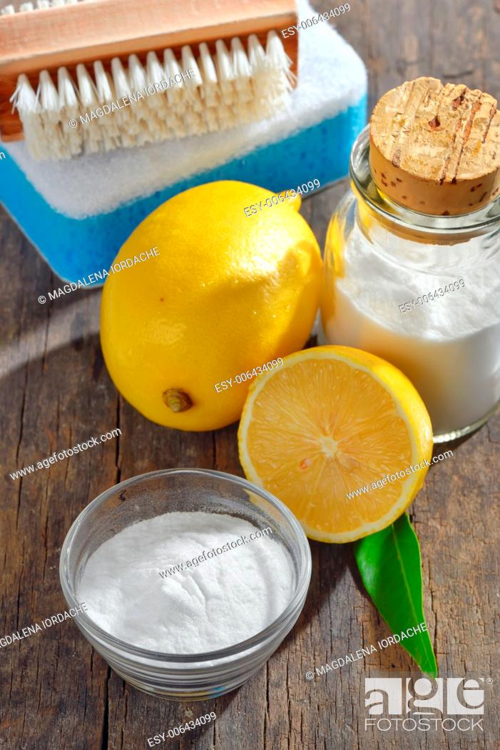 Stock Photo: Homemade green cleaning.Lemon and baking soda on old wooden background.