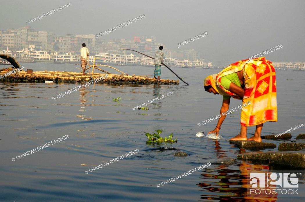 Traders transporting bamboos through the Buriganga river