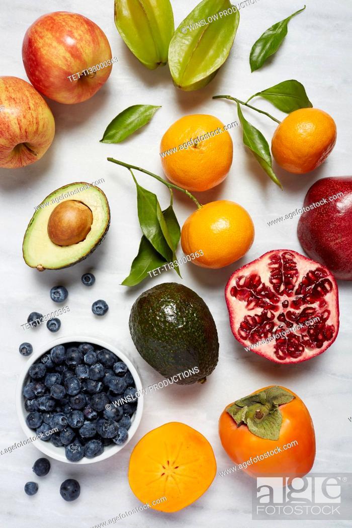 Stock Photo: Fruits on white surface.