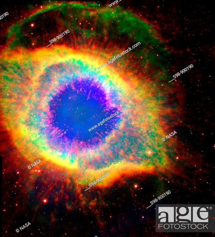 Stock Photo: Named for its resemblance to a coiling spiral seen face on, the Helix Nebula NGC 7293 is a challenging stargazing target that has a more complex.