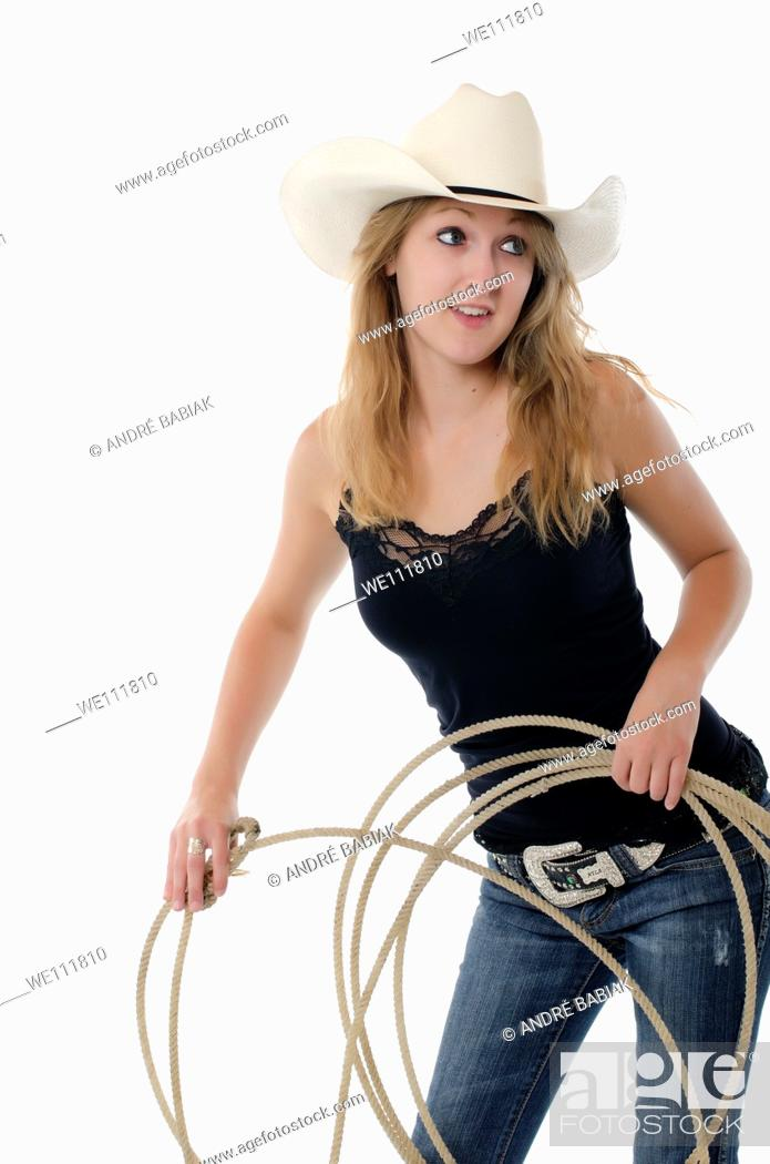 Stock Photo: Young cowgirl posing at studio.