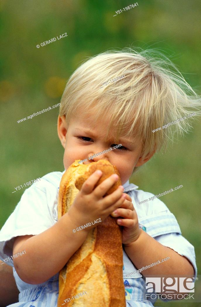Stock Photo: Girl eating French Bread Stick.