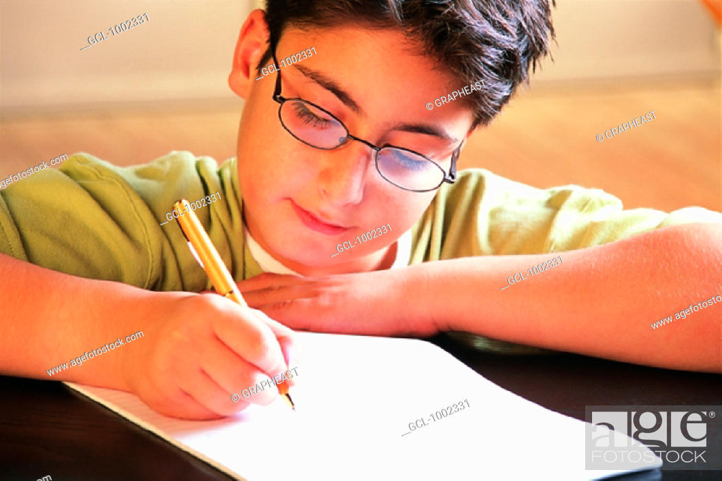 Stock Photo: Pupil writing.