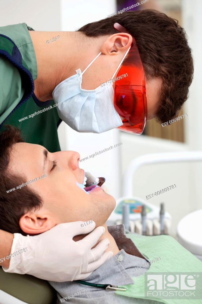 Stock Photo: Medical treatment at the dentist clinic.