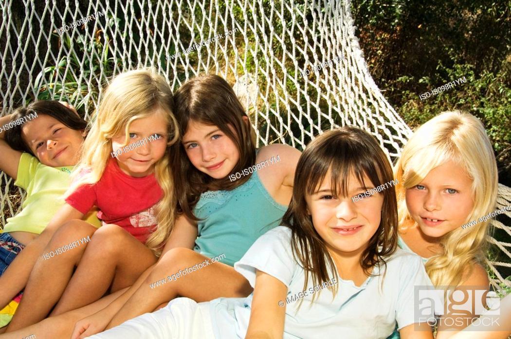 Stock Photo: Girls in a hammock.