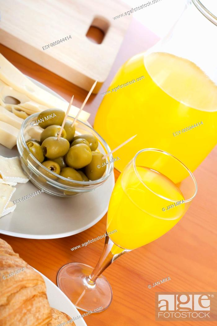 Stock Photo: Detail of kitchen table with fresh olives and juice.