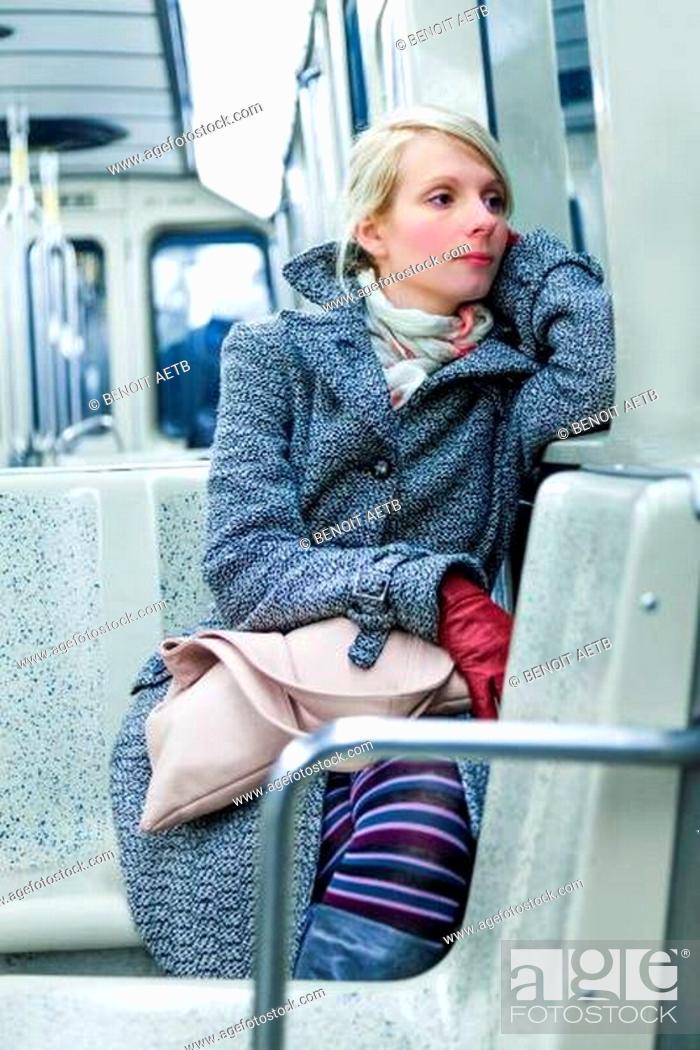 Stock Photo: Young Woman Sitting inside a Metro Wagon.