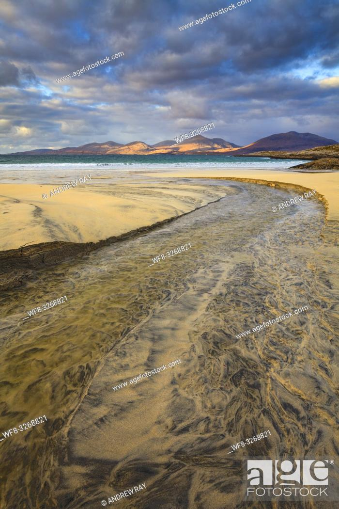 Stock Photo: The stream on Luskentyre Beach on the Isle of Harris, with the hills of North Harris in the distance captured on a stormy afternoon in late October.
