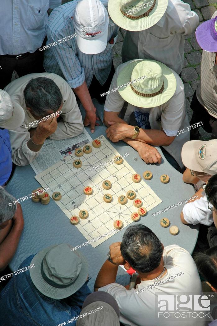 Stock Photo: Toronto, Canada: Chinese men playing Chinese chess at Chinatown.