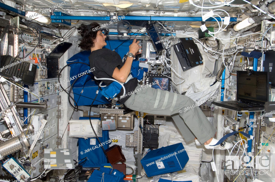 Stock Photo: NASA astronaut Sunita Williams, Expedition 32 flight engineer, works on the Reversible Figures (RFx) experiment in the Columbus laboratory of the International.