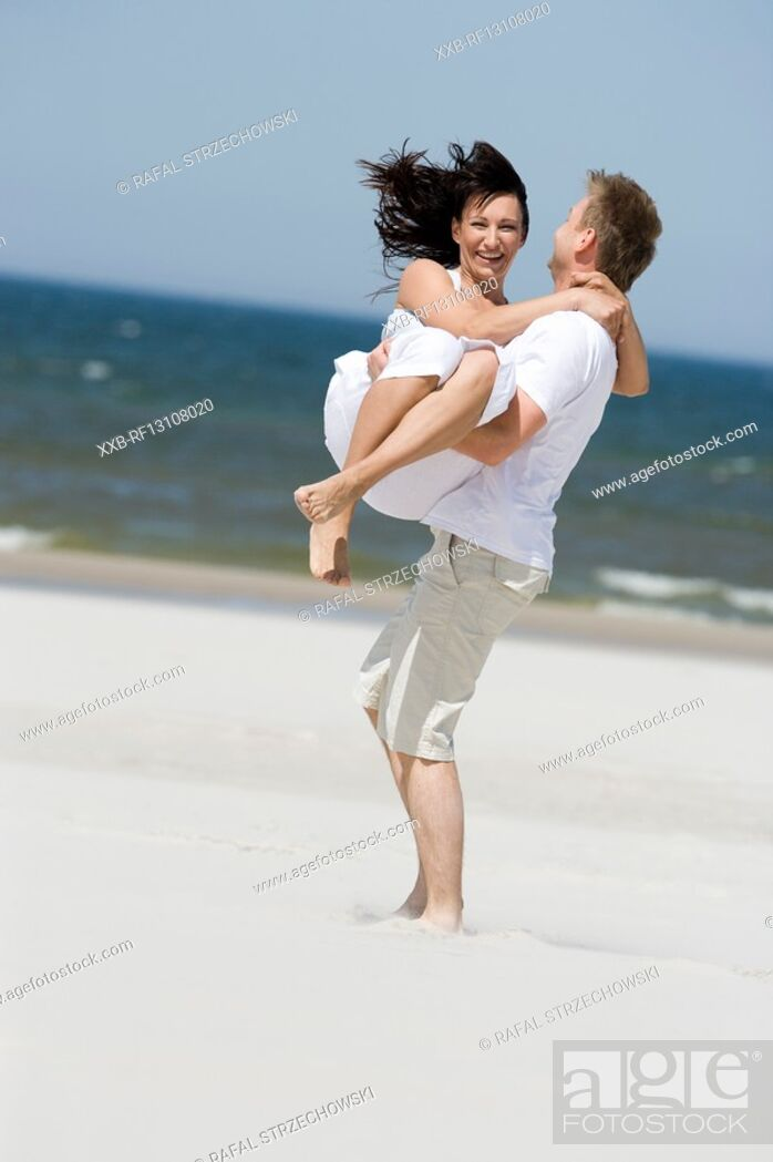 Stock Photo: happy couple on beach.