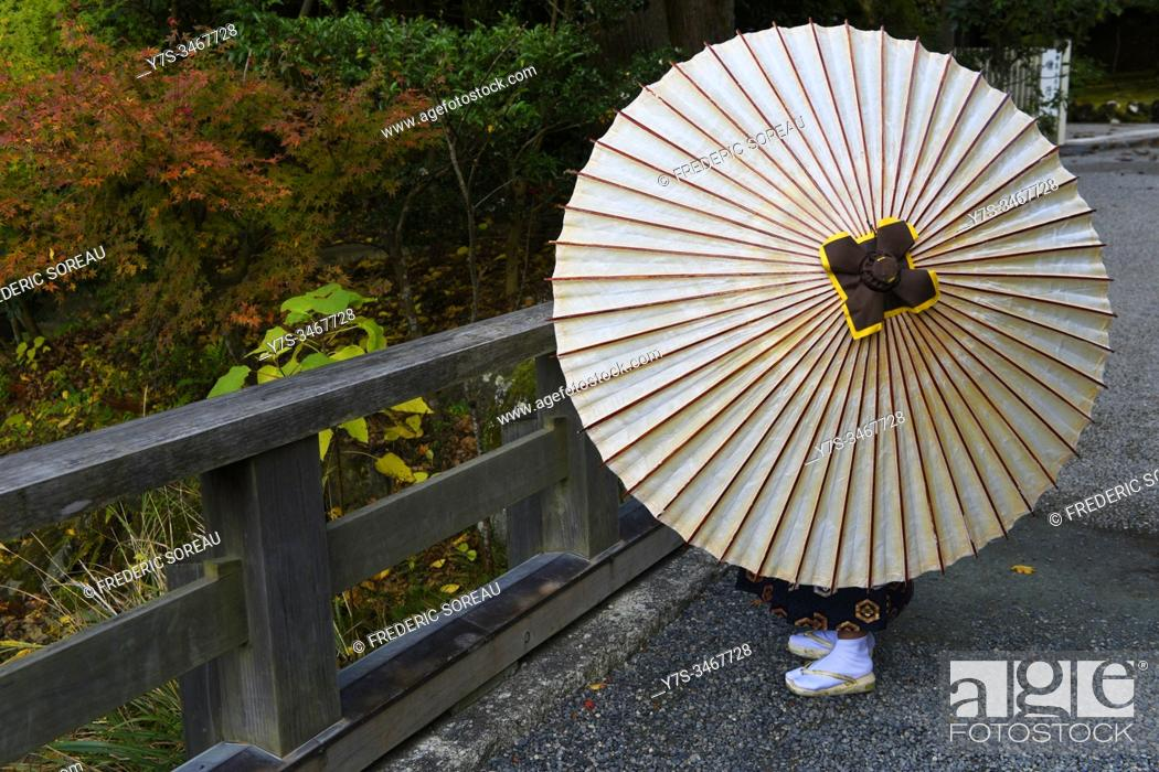 Stock Photo: Young boy with an umbrella in Ise jinju, Honshu, Japan, Asia.