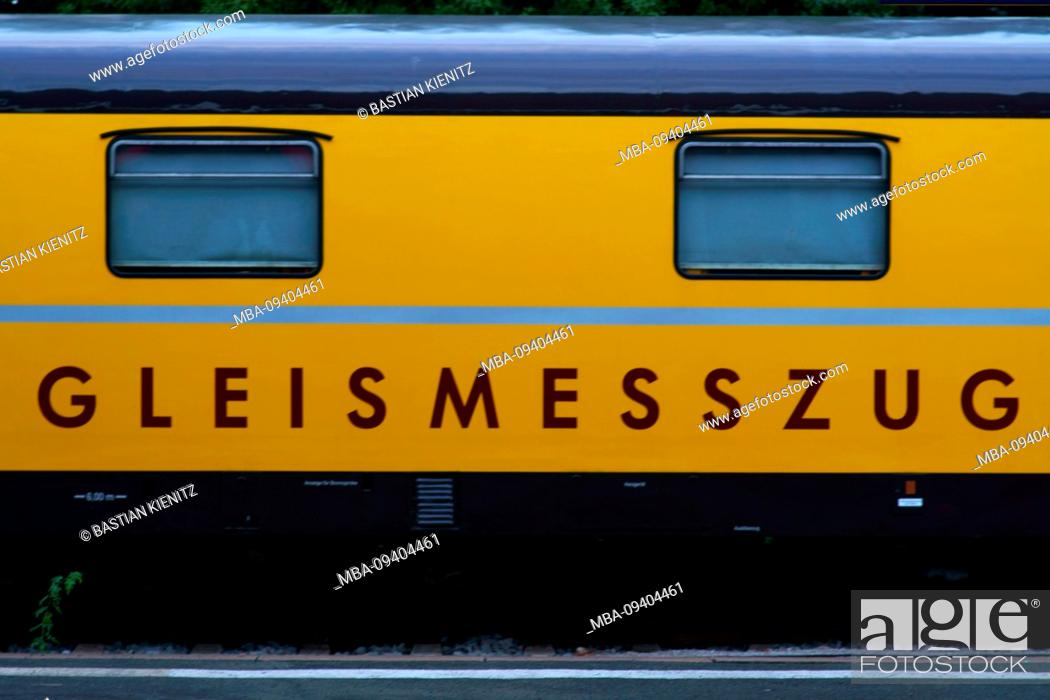 Stock Photo: The close-up of the yellow body of a track train or rail vehicle.