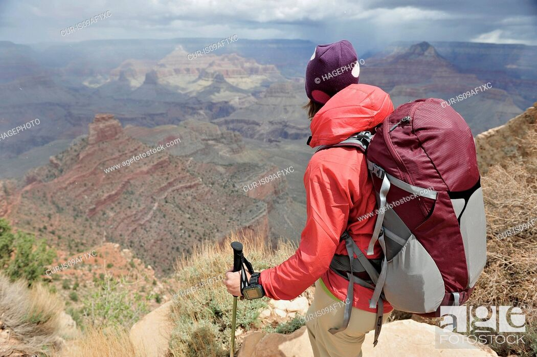 Stock Photo: Female hiker looking toward Grand Canyon, Flagstaff, Arizona, USA.