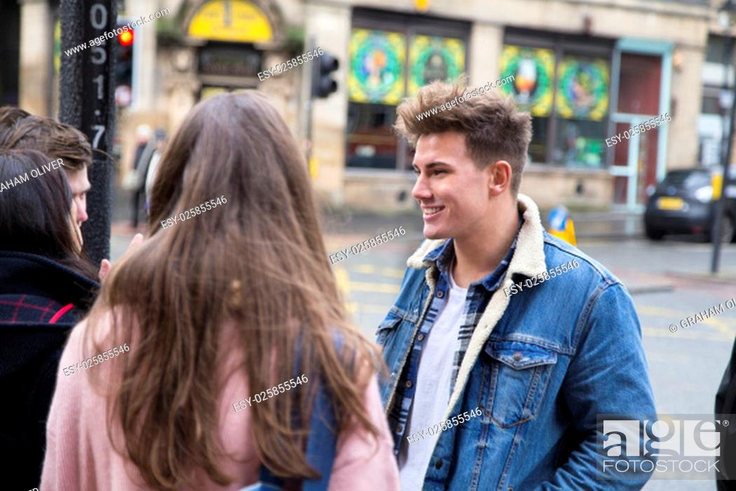 Stock Photo: Group of young adults talking in the city.