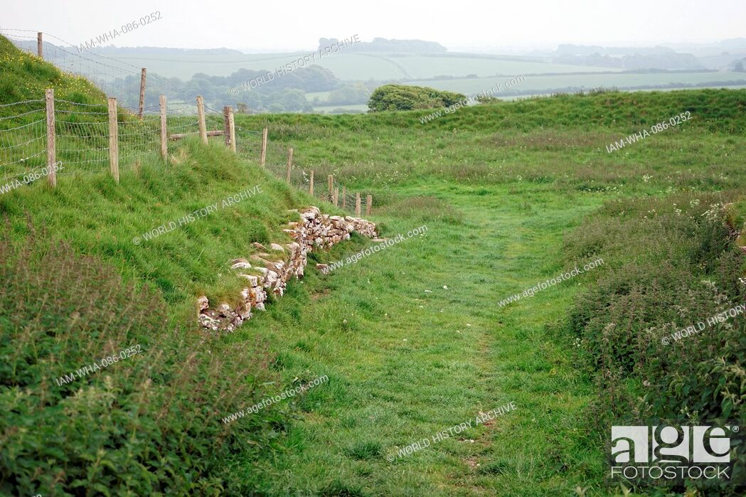 Stock Photo: View of Maiden Castle, an Iron Age hill fort, a type of earthworks used as a fortified refuge which would exploit elevations. Dated 21st Century.